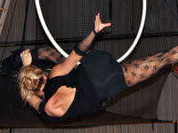 Kristi performing a Aerial Hoop routine in an IPC Show