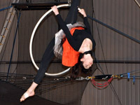 Student performing a Aerial Lyra routine in an IPC Show