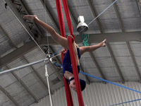 Emily performing a Silks routine in our IPC Beach Show